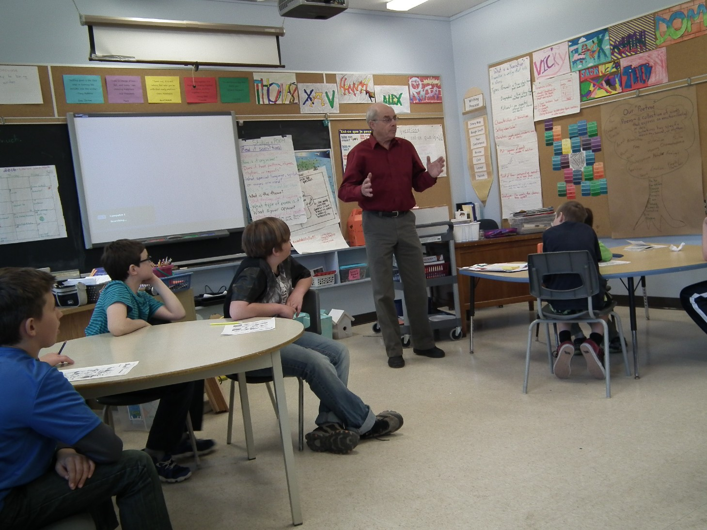 Hatchery member Bruce Campbell teaches a series of lessons about the hatchery, fish habitat, ecology and conservation