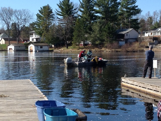 boat and crew opening the net to remove pickerel